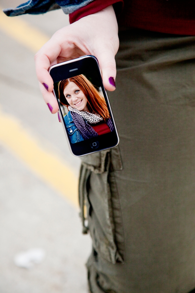 girl holding iphone with picture on it